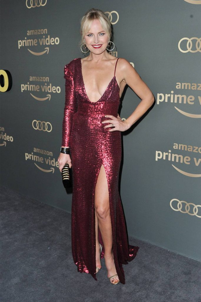 Malina Akerman weras burgundy metallic sequin gown attending Goldon Globes Party